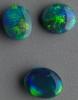Black Opal set in green  Lightning Ridge